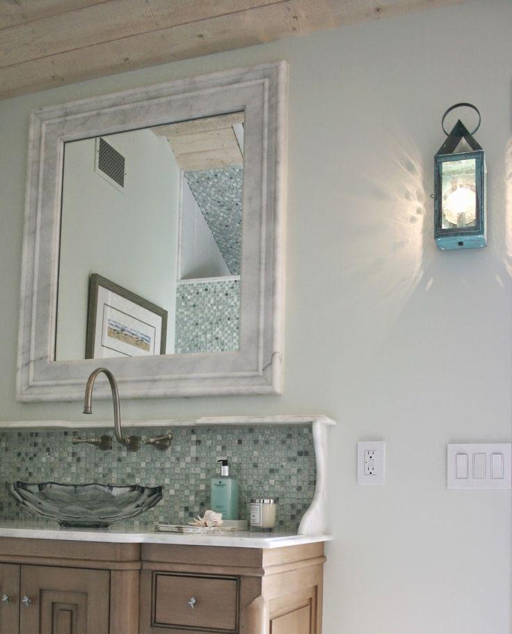 "vintage inspire vanity and lighting in this bathroom.  ""love the back splash}"