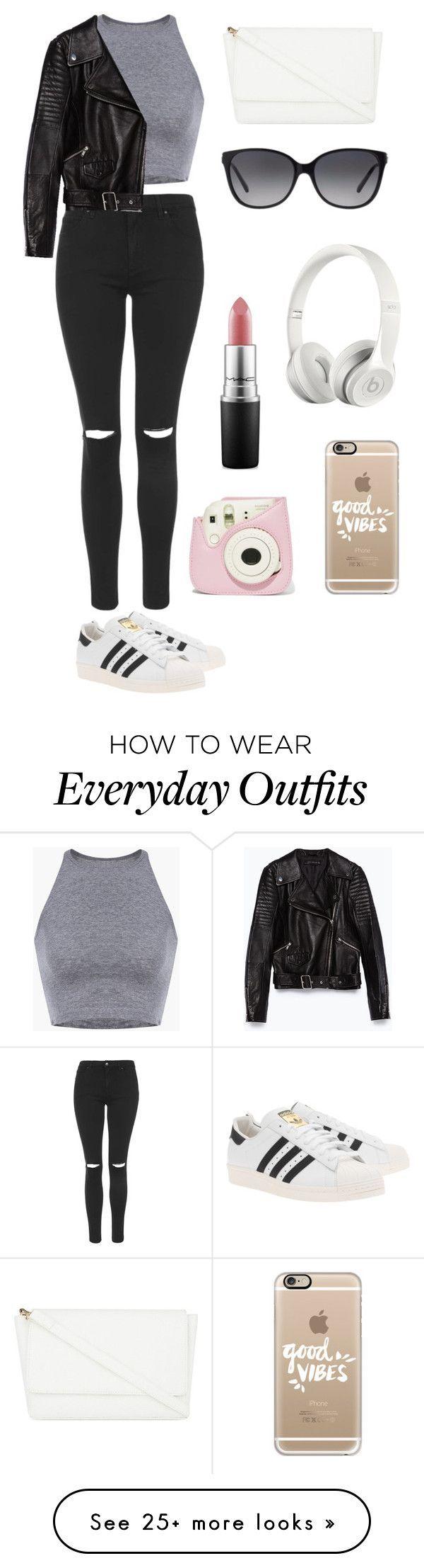 Pantalón negro, blusa gris,chaqueta negra,zapatos blancos