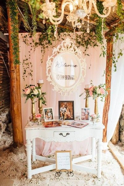 Vintage, lush wedding welcome table idea - blush backdrop, vintage white chest with gold candles and flowers {ShoeBox Photography}