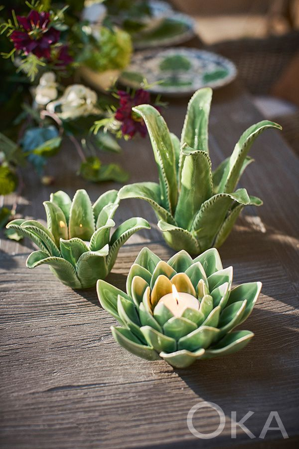 This unusual set of three ceramic tea light holders from OKA includes two short plants (one aloe vera, one artichoke) and one taller aloe vera plant.