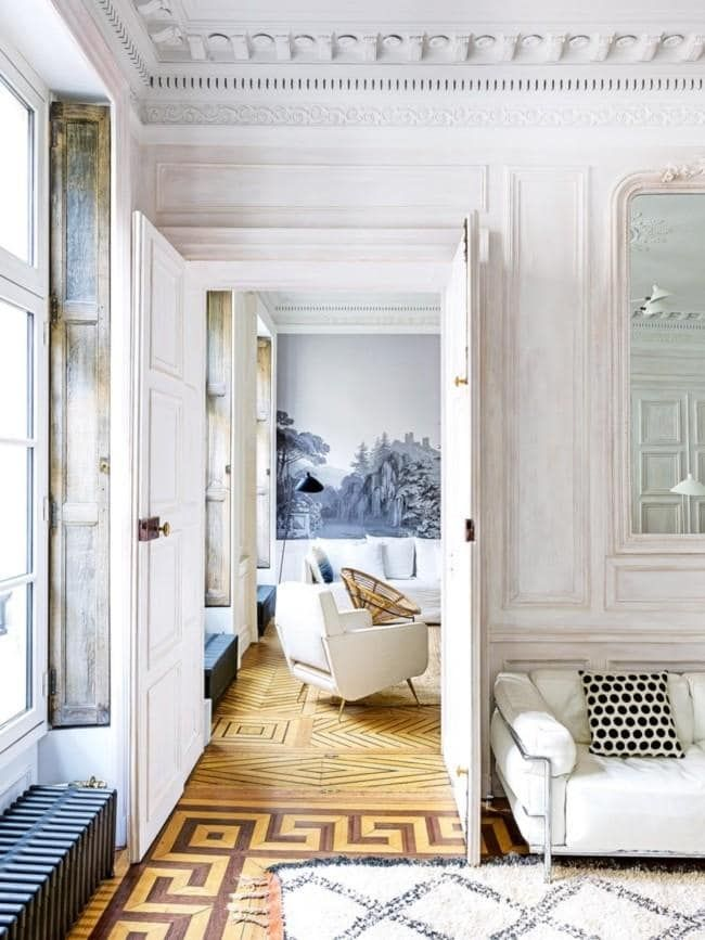 Play with flooring According to the French parquetry flooring is the chicest way to finish any room. Take it up a level by installing patterns within the timber for a unique take on Parisian style. Oui oui! Key pieces: parquetry floorboard Photograph by Stephan Julliard