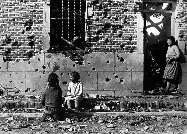 Photo by Robert Capa: Children in a ruined street of Madrid, Spain, during the Spanish Civil War, 1936.
