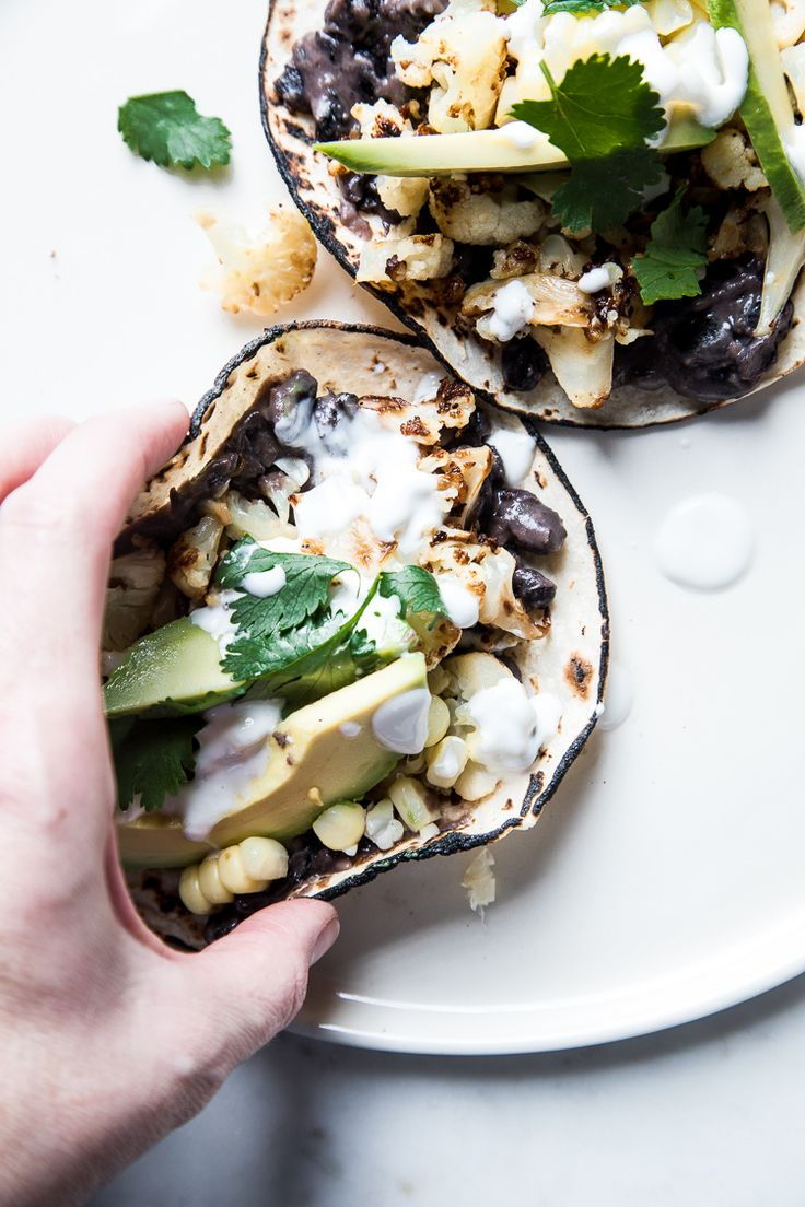 Roasted cauliflower, corn, and black bean tacos by Flourishing Foodie
