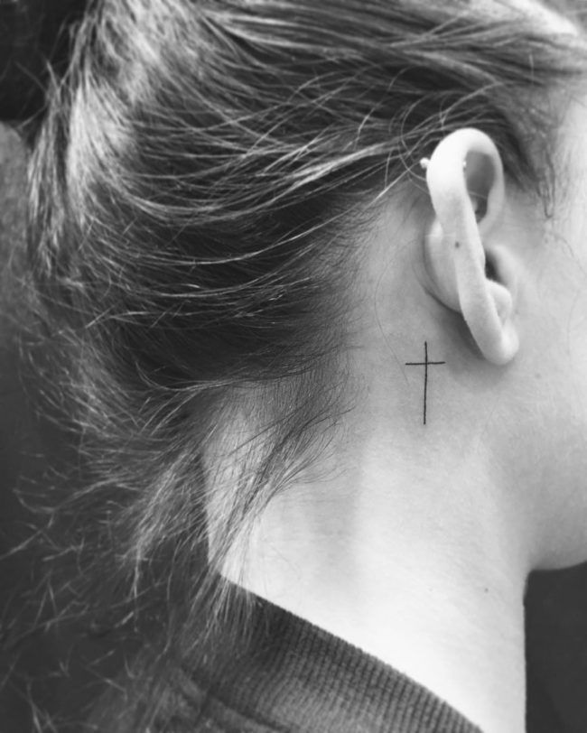 Small cross tattoos on neck