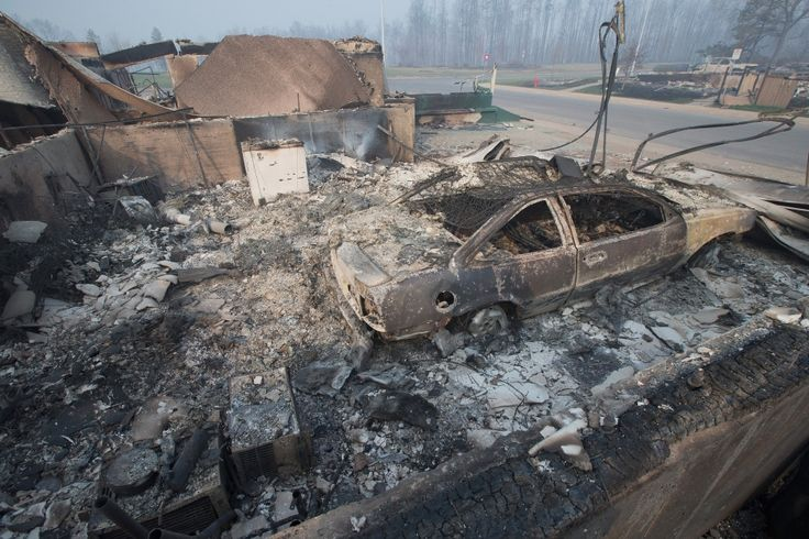 Photographers went to the devastated Fort McMurray neighbourhood of Beacon Hill on Friday, and emerged with haunting images.