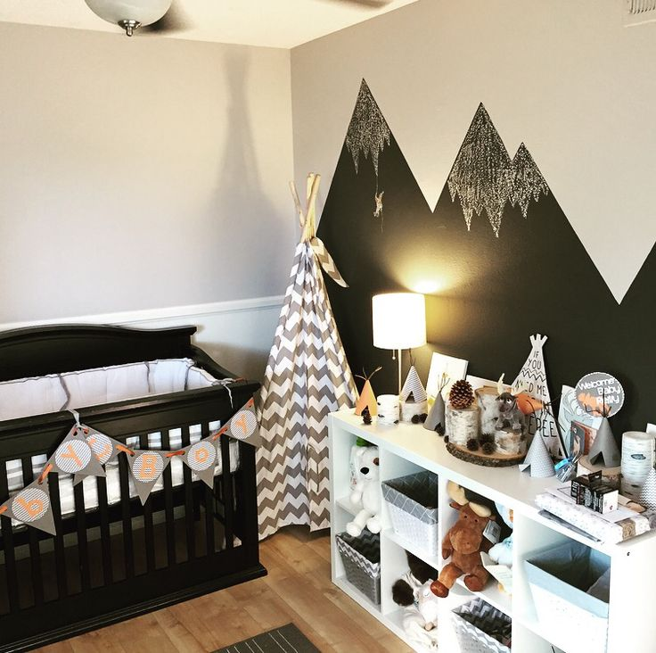 Gray, white and orange baby nursery. Woodland Native American teepee. Dark black crib.