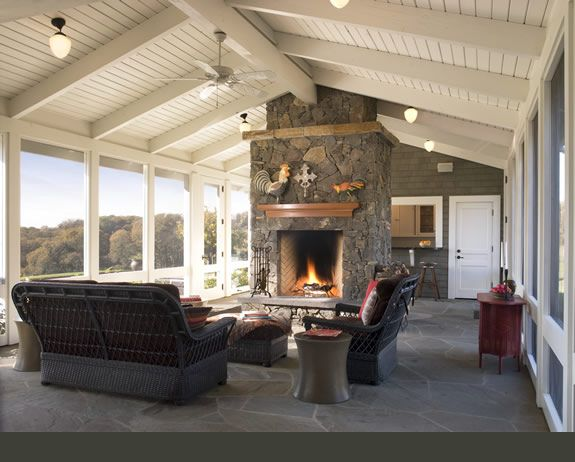 Beautiful porch with fireplace and natural light.
