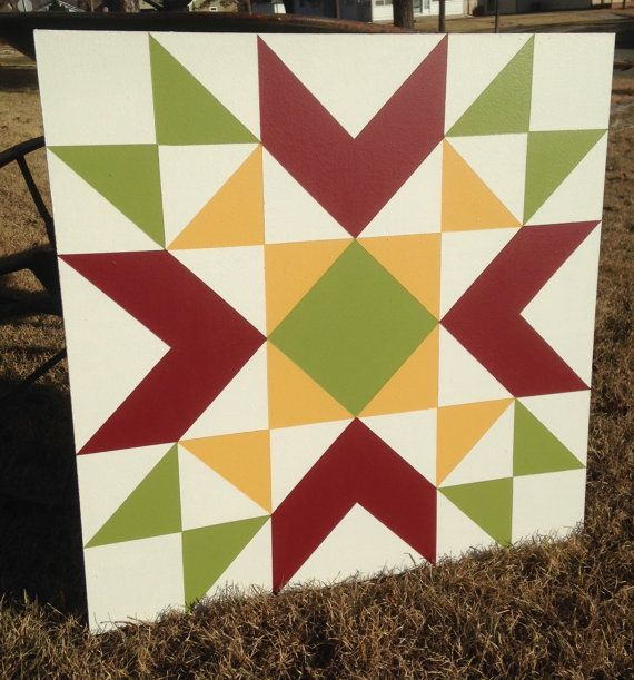 This 2 ft. x 2 ft. Midwestern Star barn quilt was hand painted on MDO plywood and finished with 3-4 coats of exterior primer to protect from the elements. It is a perfect addition to your barn, garage, front porch or garden fence! No hanging hardware included. Made and shipped from Kansas. Thank you for your interest in our shop! Please check us out on Facebook for even more current designs and design ideas. www.facebook.com/frontporchtreasures/