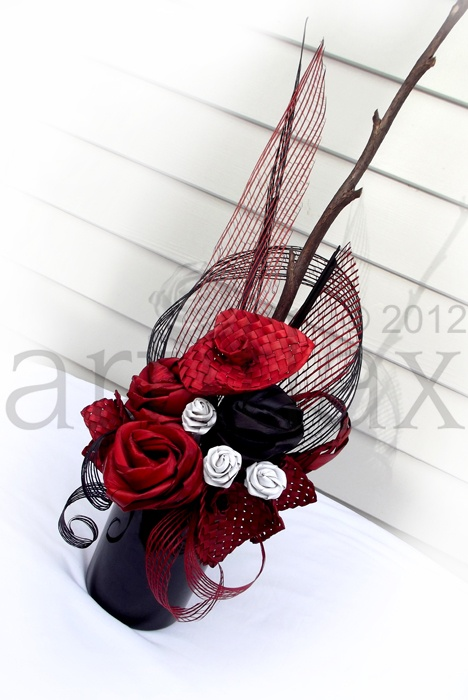 Artiflax - corporate    Red, Black and white flax flowers arranged in a black vase