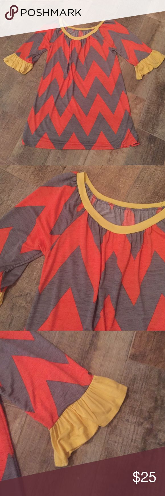 NWOT Chevron top NWOT. This has never been worn. No holes or stains. Super cute top. Tops Tunics