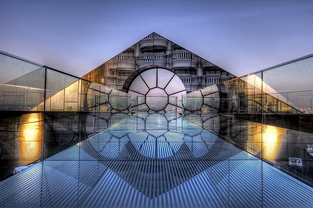 Reflection of setting sun on the pyramid-shaped facade Breeze, Lebua, Bangkok, Thailand. www.dwp.com