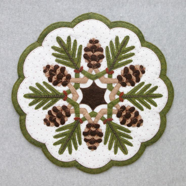 Pinecones : DesignAndBeMary.com - This is a clean and fresh design.  Nicely done. The page is an invitation to buy - the pattern is ten bucks.