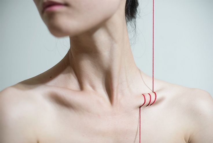 Taiwanese artist yung cheng lin visualizes body modification with the simplicity of weaving red thread in and out of the female form with digital artistry.