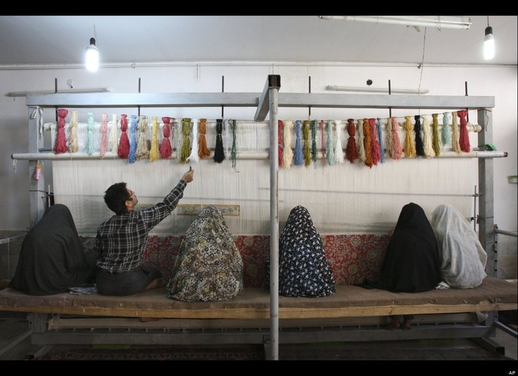 this Saturday, Nov. 12, 2011 photo, Iranian women and a man weave carpet in a workshop in Qom, 78 miles (125 kilometers) south of the capital Tehran, Iran.