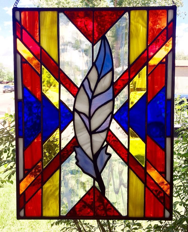 Stained glass panel, feather and Indian blanket.https://www.etsy.com/shop/NightShiftGlass