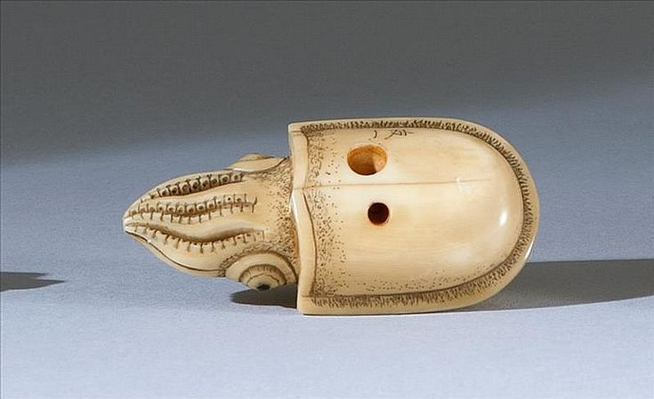 """IVORY NETSUKE By Tomokazu. In the form of a squid with inlaid eyes. Length 2.2"""" (5.5 cm)"""