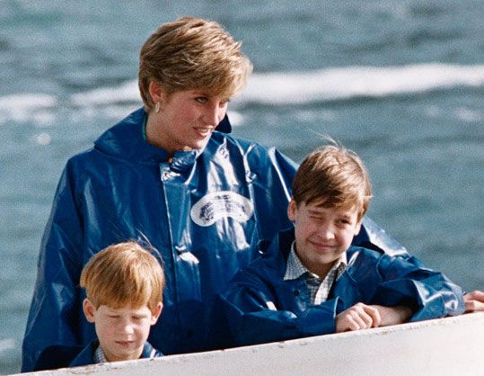 Princess Diana along with her two sons Prince William and Harry visit Niagara Falls and take the Maid of the Mist to the base of the Falls. (© Reuters/CORBIS)