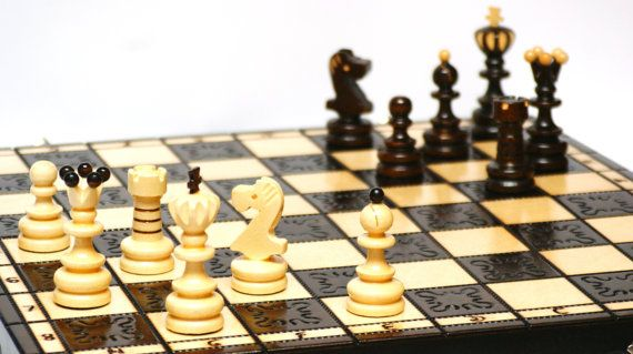 Hand carved chess board and pieces  https://www.etsy.com/listing/205327339/wooden-handmade-big-chess-board-and