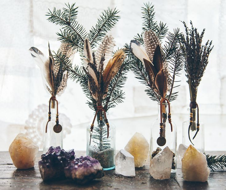 vases with crystals, feathers, pine