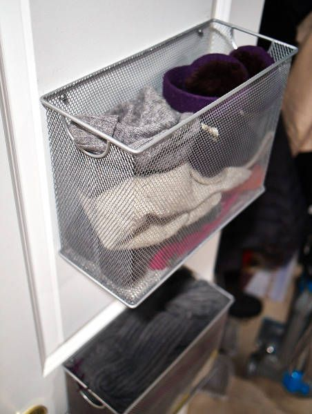 Need an unobtrusive place to store your winter necessities? Blogger The Baloney Bug repurposed Target filing trays as winter storage, screwing them into the back of her closet door and filling them with hats and gloves. - HouseBeautiful.com