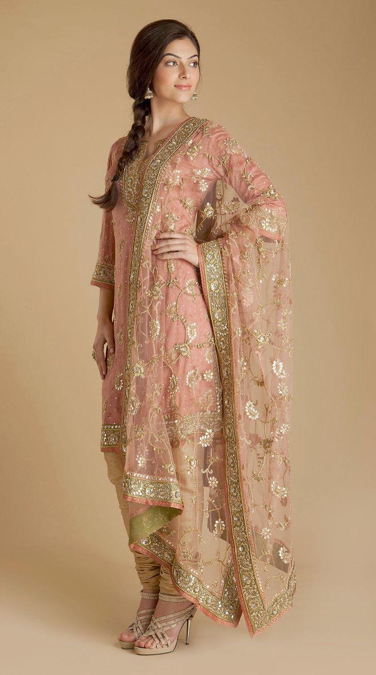 Pretty light pink salwar and kurta with dupatta. Indian fashion.