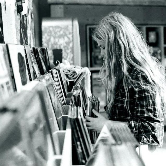 flipping through the record albums at the music store.
