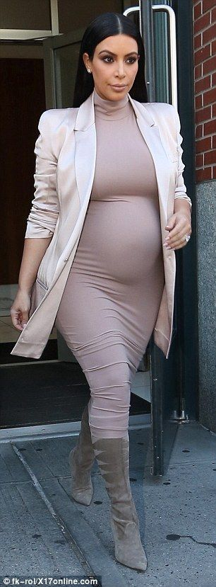 Pretty in pink: Kim Kardshian wore a blush ensemble in New York on Monday...