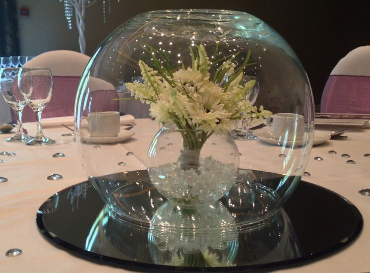 Awesome Simple Bouquet Centre Piece Encased In A Rose Bowl, On A Mirror Tile Base.