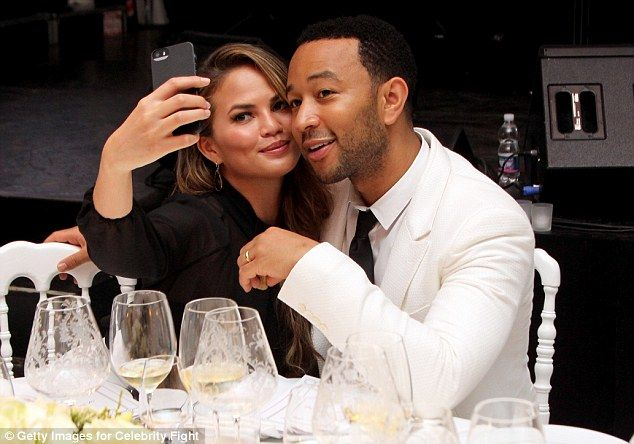 Selfie: The couple cosied up to take a photo on Chrissy's phone...