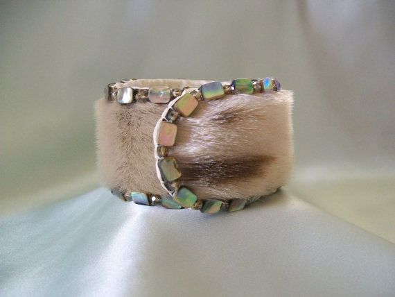 Sealskin bracelet with abalone. I will own one of her pieces, one day. My sister's friend Shaaxsaani. Tlingit Artist from Southeast Alaska.