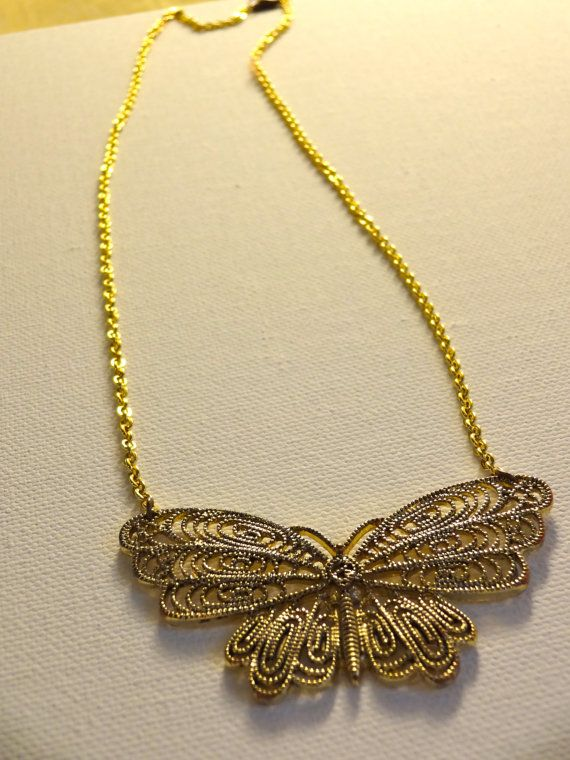 Gold coloured butterfly bib necklace