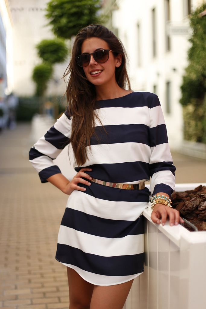 Belting a bold stripe keeps you looking slim and dresses up a casual style.
