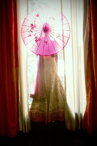 Indian wedding: Love this back-lit shot and stunning, exotic parasol.