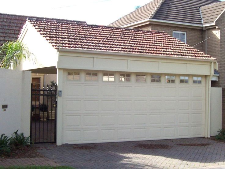Carport roller door walkerville pesbuild kenzi for Carport landscaping ideas