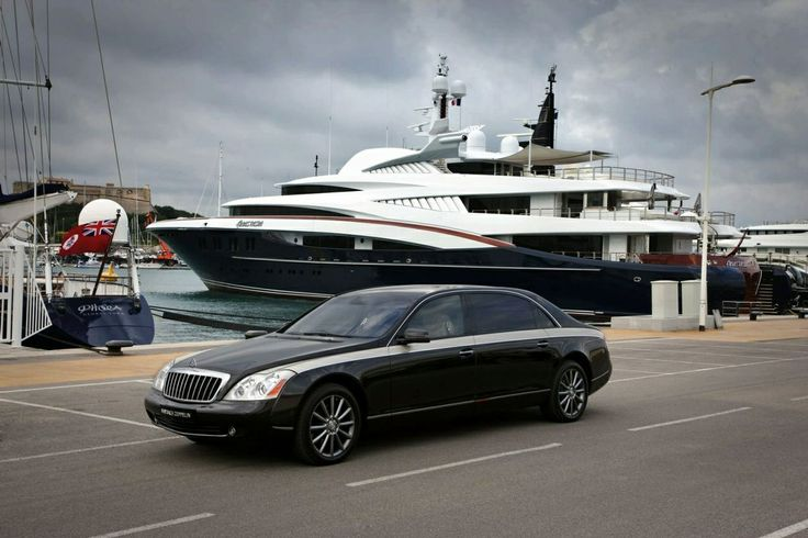 Maybach 62s in front of a yaght