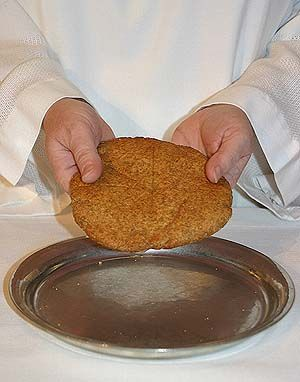 Luther Seminary's   Communion Bread Recipe  Sift dry ingredients (important!) together three times:  2 c whole wheat flour  1 c white flour  1 & 1/4 tsp baking powder  1 & 1/4 tsp salt  Stir in 4 tsp oil. Set aside.  Mix wet ingredients together until dissolved:  3/4 cup + 2 Tbsp very hot water (minimum of 180 degrees F)  3 Tbsp honey  3 Tbsp molasses  Add wet ingredients to dry ingredients and mix well. Dough should be slightly sticky. Do not knead.  Divide into four balls and flatten each…