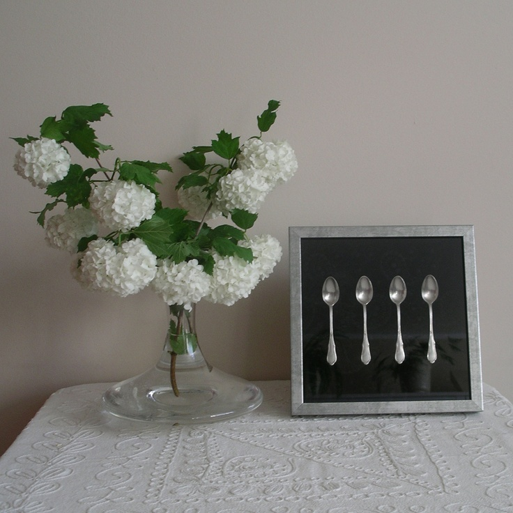 3D wall decoration Four silver-plated spoons.