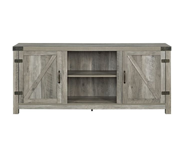 Understated style meets rustic farmhouse flair to give this handsome TV stand a look that instantly elevates any space. Its raised geometric details add a dash of dimension to your decor while its wood grain details pair perfectly with plank-inspired wall decor and rich faux-leather upholstery. Play up this piece's rustic influence by adding it to a living room ensemble comprised of chocolate-hued wingback chairs and foam-filled reclining sofas for a cozy and cohesive seating group. Ancho...