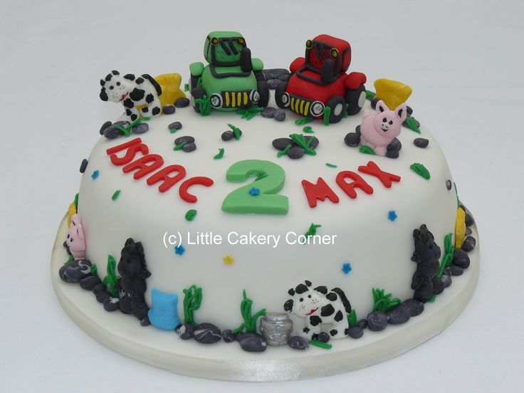A fabulous birthday cake for children, boys or girls, who love tractors, farms or farm animals!  This particular cake was made for twins for their 2nd birthday - and so features 2 of everything - including one red tractor and one green tractor!  There are pigs, cows, horses, hay bales, a milk churn, bag of feed, grass and rocks.  Great for a 1st birthday or any age!  Even for a farmer!
