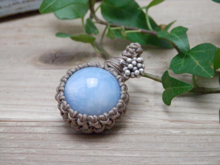 aquamarine and a silver charm