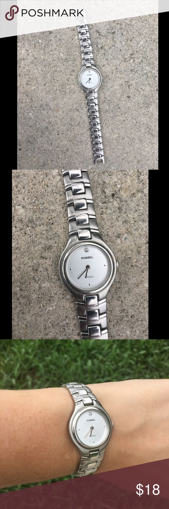 "Fossil Stainless Steel with Genuine Diamond Watch Fossil smooth fit link watch. Well loved. Needs battery! Price reflects need of battery but price to replace is minimal at any mall watch shop. Genuine diamond at 12 o clock on the face. Band fits size 7"" wrist securely. Originally $75! Only one owner! Fossil Accessories Watches"