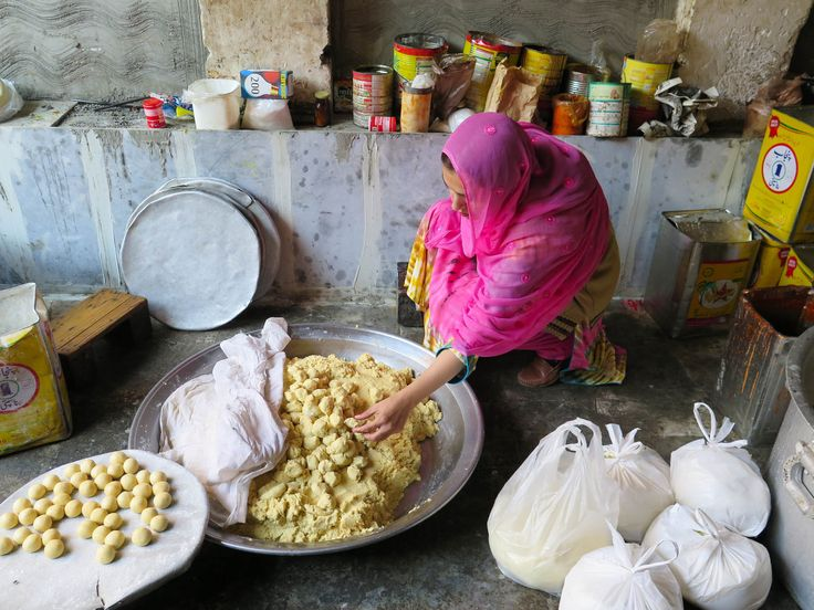 """Ayesha Mumtaz inspects food during a raid on a backyard sweets factory in Lahore, Pakistan. Her campaign to clean up the kitchens and food factories of Pakistan has earned her the nickname """"The Fearless One."""""""