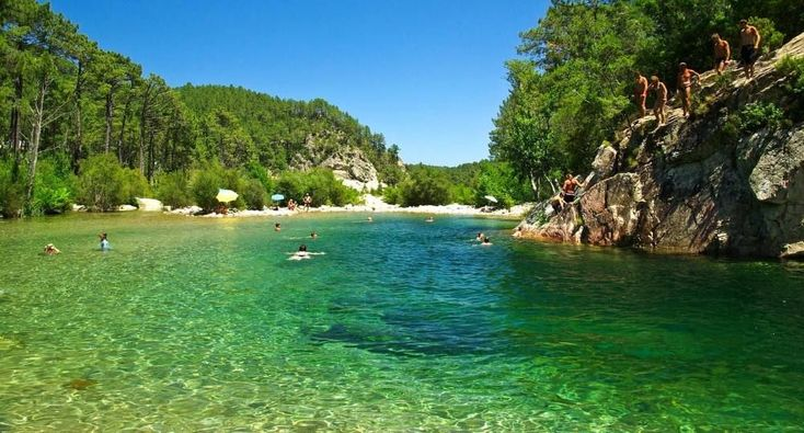 Baignade dans les eaux transparentes de la Solenzara
