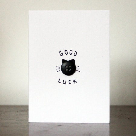 Black button kitten, ears whiskers, cat face, Good Luck, minimalist card. Hand-made good luck card with a single black button.