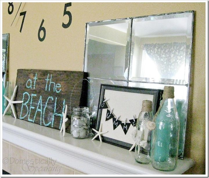 Summer mantle with starfishh, old beach bottle, beach sign.