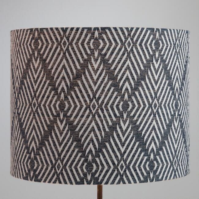 Embroidered with a white diamond design that pops from a dark indigo background our exclusive shade adds a tribal inspired motif to your decor