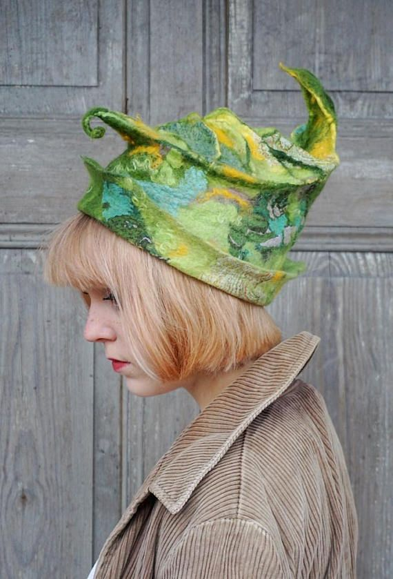 Unique fancy felted hat, sculptural hat like green leaf, elvish fairy hat, one of a kind Avant Garde fashion. I made it nuno felt technique with silk fabric and high quality Australian merino wool, decorated with pieces of silk fabric and wool curls. Shaped by hand. This hat is light and