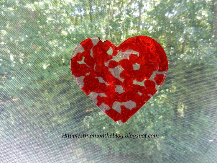 Heart sun catcher made out of melted beads #heart #sun catcher # kids craft #valentine's Day