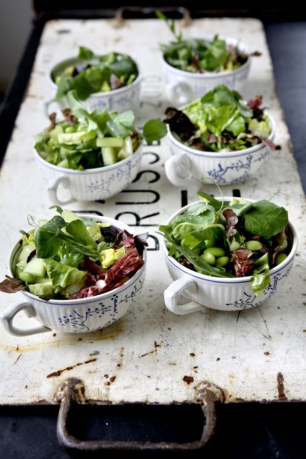 Salads serving in large teacups.  (just a photo with no info but a fun idea)