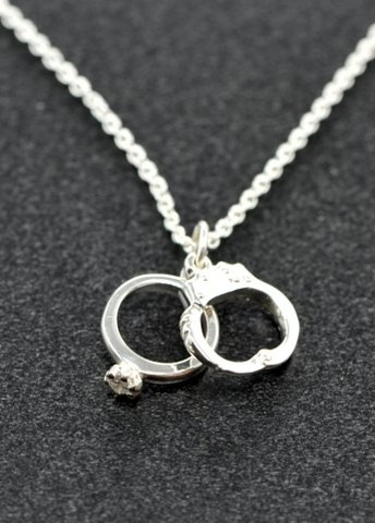 Police Wife Necklace - $150 - Sterling pendant with a .02 carat diamond set in engagement ring.  Show your appreciation and support for your spouse in law enforcement by wearing this pendant on a necklace with pride.